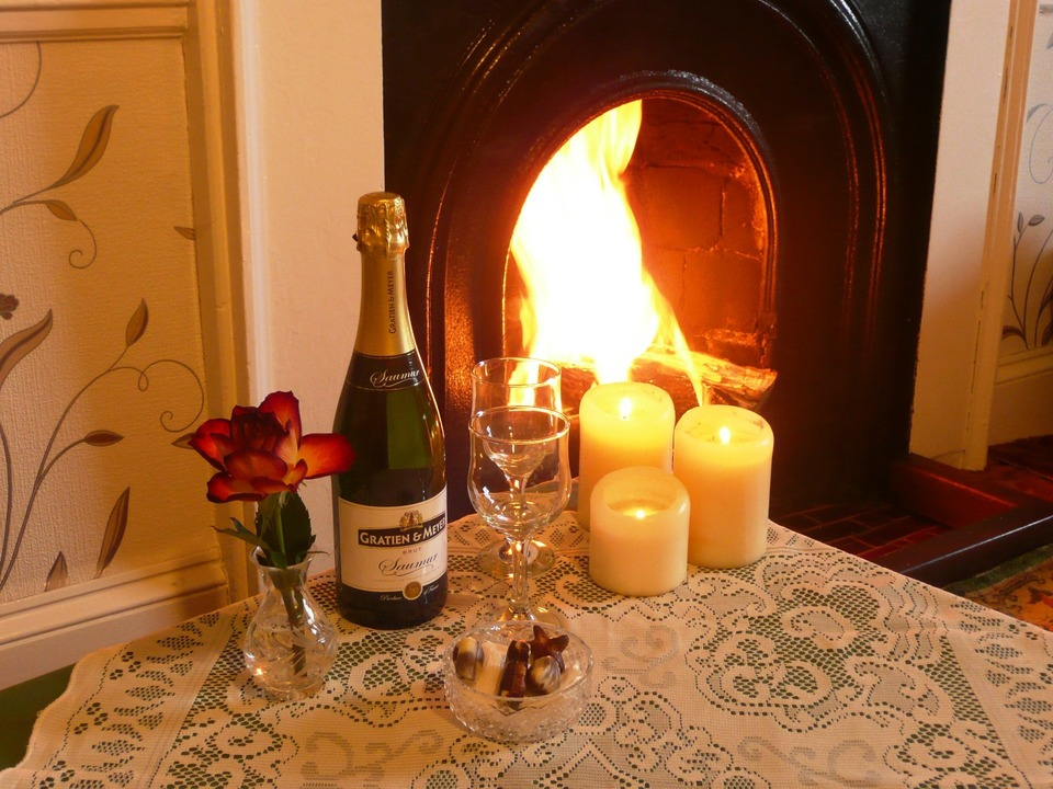 Champagne, candles and a roaring fire